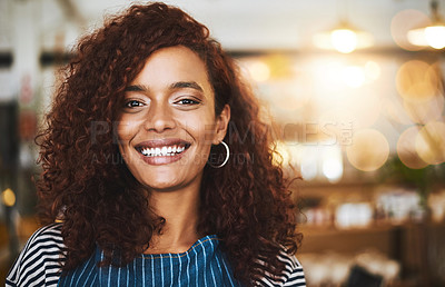 Buy stock photo Cropped portrait of an attractive young woman standing in her coffee shop