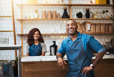Buy stock photo Cropped portrait of a handsome young man standing with his hand on his hip in his coffee shop