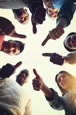 Buy stock photo Low angle shot of a group of students giving thumbs up together
