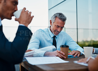 Buy stock photo Cropped shot of corporate businessmen having a meeting outside