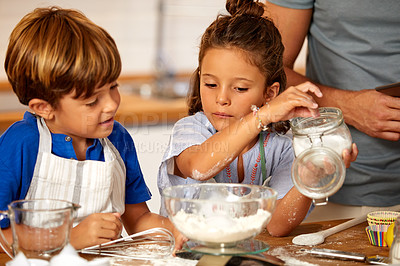 Buy stock photo Cropped shot of an adorable brother and sister baking in the kitchen