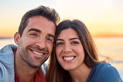 Buy stock photo Portrait of a happy young couple enjoying some time together outdoors