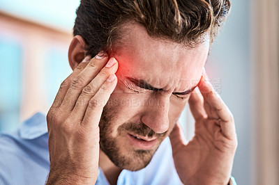 Buy stock photo Shot of a uncomfortable looking man holding his head in discomfort due to pain at home during the day