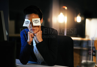 Buy stock photo Shot of a young businesswoman working late in an office with adhesive notes covering her eyes