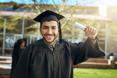 Buy stock photo Portrait of a happy young man holding a diploma on graduation day