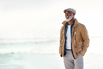 Buy stock photo Shot of a mature man enjoying a day at the beach