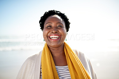 Buy stock photo Portrait of a mature woman enjoying a day at the beach