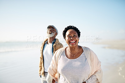 Buy stock photo Portrait of a mature woman enjoying some quality time with her husband at the beach