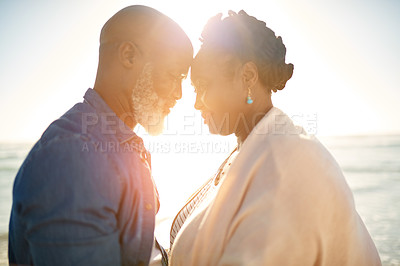 Buy stock photo Shot of a mature couple standing face to face at the beach