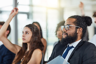 Buy stock photo Cropped shot of a handsome young businessman attending a seminar with his colleagues