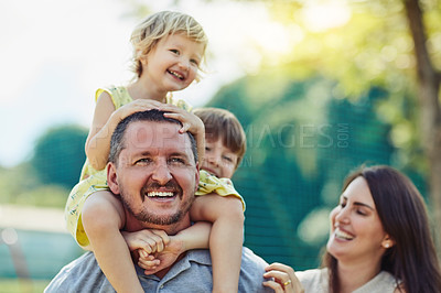 Buy stock photo Shot of a happy family bonding together outdoors