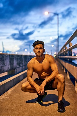 Buy stock photo Portrait of a young man exercising outdoors