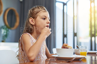 Buy stock photo Shot of an adorable little girl enjoying a meal at home