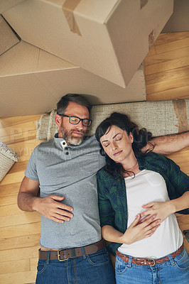 Buy stock photo High angle shot of a couple taking a nap together on moving day