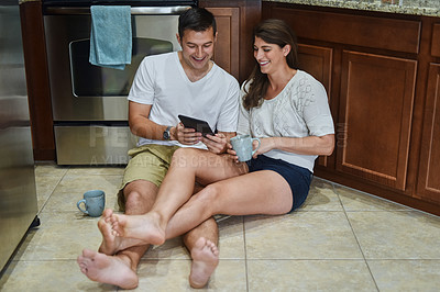 Buy stock photo Shot of young couple spending their day indoors