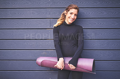 Buy stock photo Cropped portrait of an attractive young female athlete carrying her yoga mat