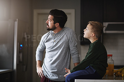 Buy stock photo Cropped shot of a handsome young man and his son in the kitchen at home