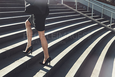 Buy stock photo Cropped shot of a businesswoman walking up urban steps