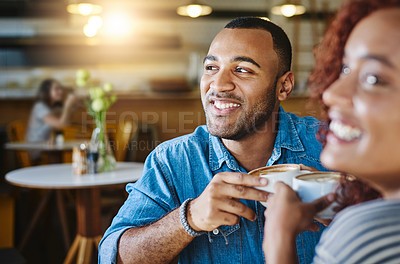 Buy stock photo Cropped shot of a handsome young man spending time with his girlfriend in a coffee shop