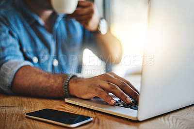 Buy stock photo Closeup shot of an unrecognizable man drinking coffee while working in a cafe