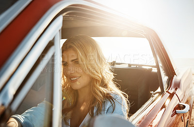 Buy stock photo Shot of a beautiful young woman going on a summer's road trip