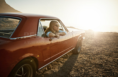 Buy stock photo Shot of a young woman enjoying a road trip along the coast