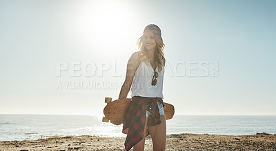 Buy stock photo Cropped shot of an attractive young woman holding a skateboard while on a road trip