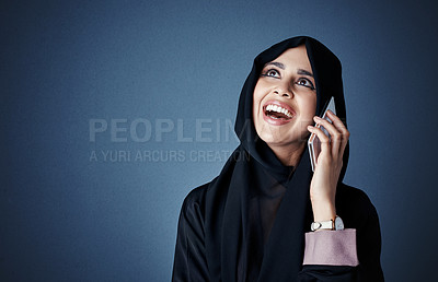 Buy stock photo Cropped shot of an attractive young businesswoman making a call while standing against a dark background