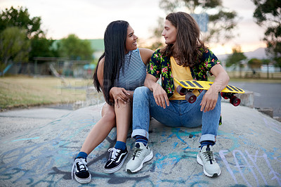Buy stock photo Shot of a beautiful young couple at a skatepark outside