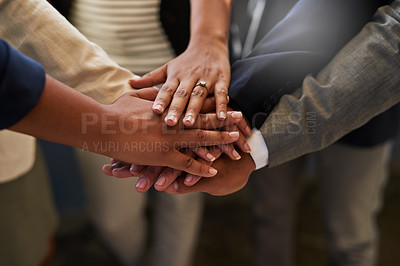 Buy stock photo Closeup shot of a group of unrecognizable businesspeople joining their hands together in a huddle