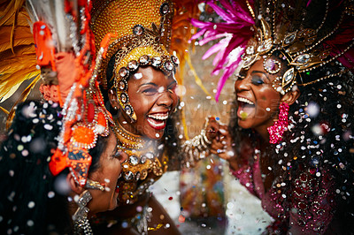 Buy stock photo Cropped shot of two beautiful samba dancers performing in a carnival with their band