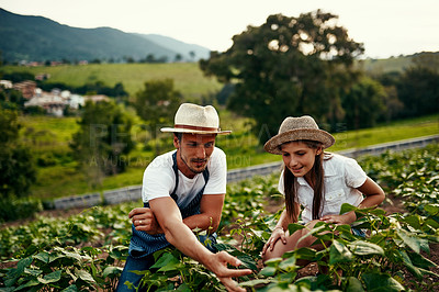 Buy stock photo Full length shot of a handsome man and his young daughter working the fields on their farm
