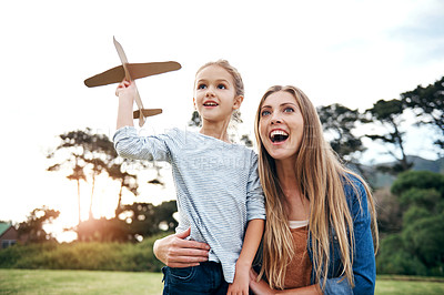 Buy stock photo Shot of an adorable little girl spending time with her beautiful mother outdoors