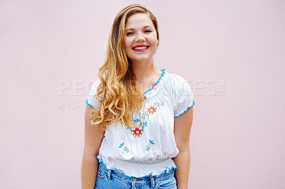 Buy stock photo Cropped shot of a beautiful young woman posing against a pink wall outside