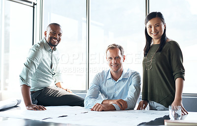 Buy stock photo Portrait of a group of businesspeople drafting a blueprint together in a modern office