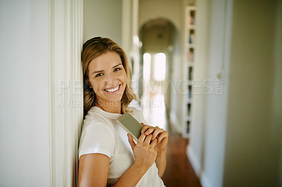 Buy stock photo Portrait of an attractive young woman using a digital tablet during a relaxing day at home