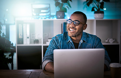 Buy stock photo Shot of a young designer working late on a laptop in an office