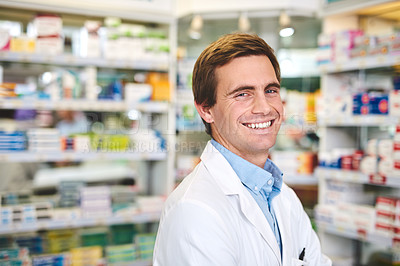 Buy stock photo Cropped portrait of a handsome young male pharmacist standing in the pharmacy