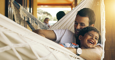 Buy stock photo Cropped shot of a father tickling his adorable son on a hammock outside