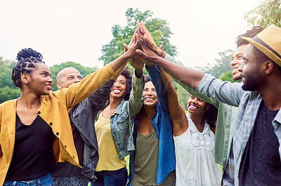 Buy stock photo Shot of a group of friends reaching for a high five