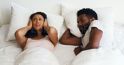 Buy stock photo Cropped shot of a beautiful wife annoyed by her handsome husbands snoring in bed at home