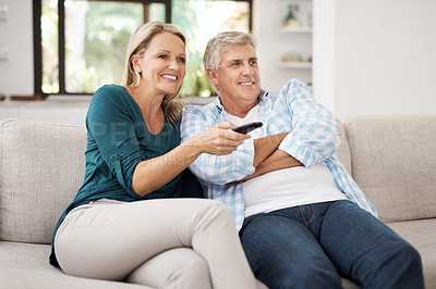 Buy stock photo Cropped shot of an affectionate mature couple watching television together at home