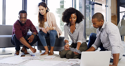 Buy stock photo Cropped shot of a group of diverse businesspeople working together on the floor in an modern office