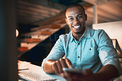 Buy stock photo Low angle portrait of handsome young male designer sending a text while working in the office