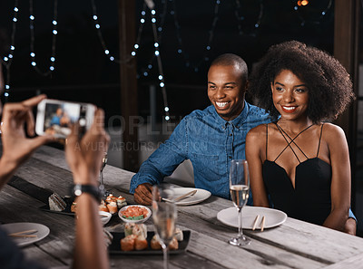 Buy stock photo Shot of a couple having their picture taken while out on a date