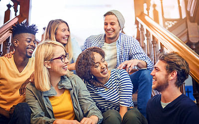 Buy stock photo Cropped shot of a group of diverse university students chilling on the staircase on campus