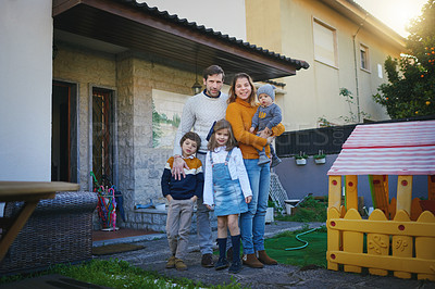 Buy stock photo Shot of a family of five standing in their backyard