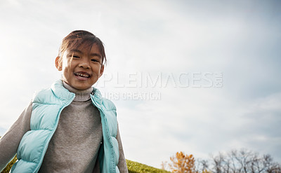 Buy stock photo Shot of an adorable little girl running around in the park