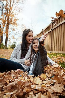 Buy stock photo Shot of an adorable little girl enjoying an autumn day outdoors