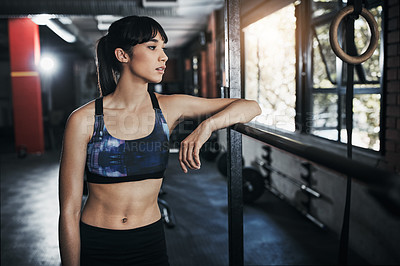Buy stock photo Cropped shot of a beautiful young woman out for a workout at the gym